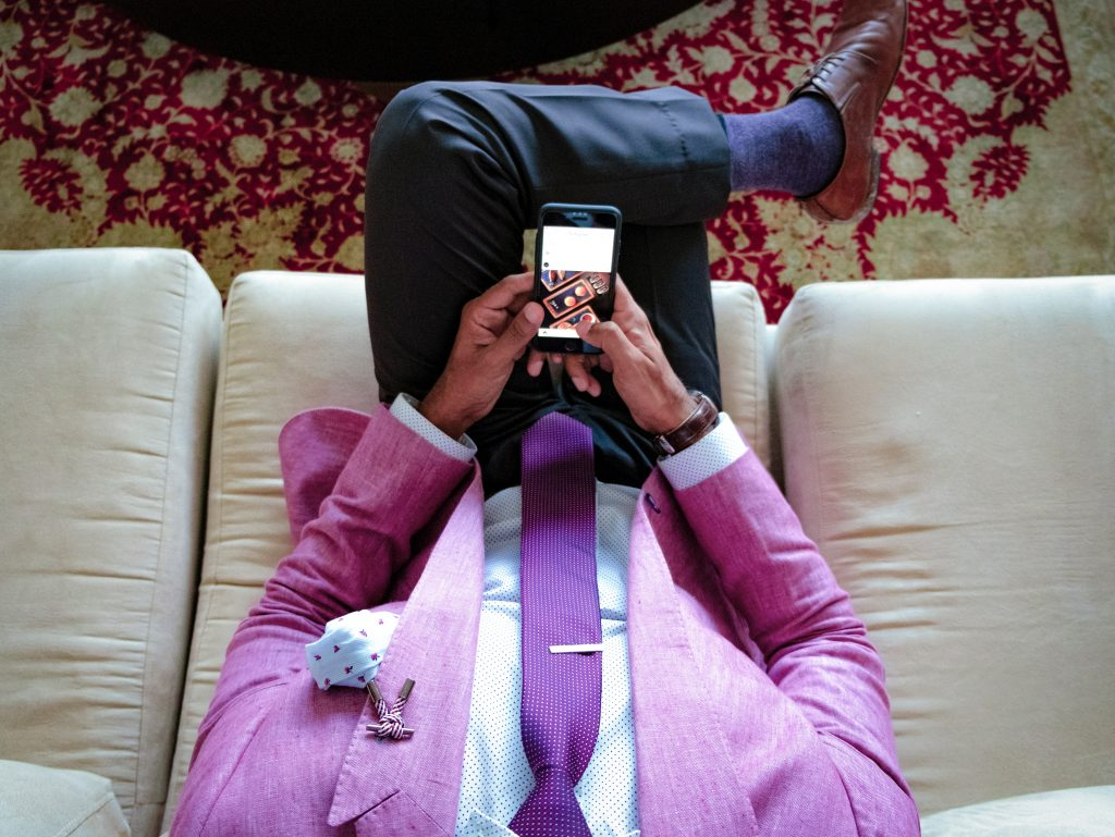 Man wearing pink suit - contact us